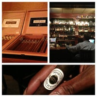 Photo taken at Downing Street Pub & Cigar Bar by Tyson D. on 7/9/2013