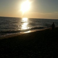 Photo taken at Marina Velca Beach by Mina on 8/22/2014