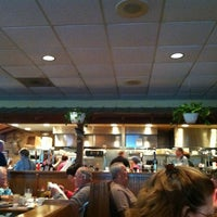 Photo taken at Oakwood Smokehouse & Grill by Laura on 3/22/2013