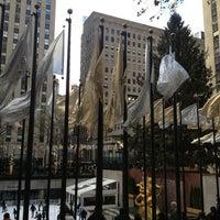 Photo taken at Rockefeller Center Christmas Tree by Kate T. on 12/25/2012