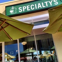 Photo taken at Specialty's Café & Bakery by Grace C. on 4/1/2011