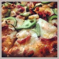 Photo taken at Reginelli's Pizzeria by Prescotte on 8/25/2013