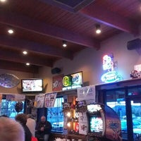 Photo taken at Features Sports Bar & Grill by John M. on 10/5/2012