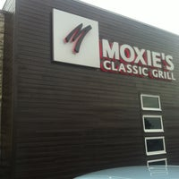 Photo taken at Moxie's Classic Grill by Julie on 5/14/2013