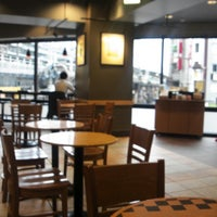 Photo taken at Starbucks Coffee 神田駅前店 by Satoshi T. on 4/18/2013