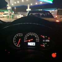 Photo taken at Emarat Petrol station by Ali M. on 7/14/2014