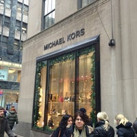 Photo taken at Michael Kors by Evren D. on 12/27/2012
