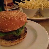 Photo taken at Gourmet Burger Kitchen by Khoo E. on 10/11/2014