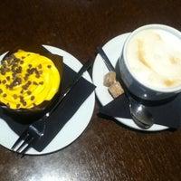 Photo taken at Café Mmuah by Alesia on 6/22/2013