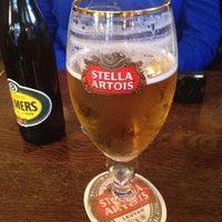 Photo taken at Leuven Belgian Beer Cafe by Chris Y. on 12/9/2012
