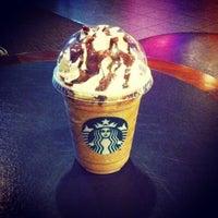 Photo taken at Starbucks Reserve by Atilla on 3/11/2013
