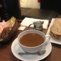 Photo taken at Macaron Café by Andrew on 3/19/2013