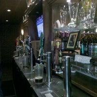Photo taken at Elliott Bay Pizza & Pub by Kim H. on 12/7/2011