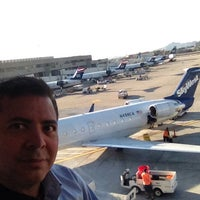 Photo taken at Gate B27 by Javier S. on 6/7/2013