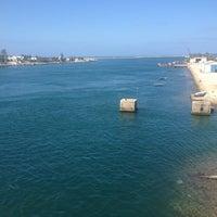 Photo taken at Pont de Bizerte by Ilyes on 6/25/2013