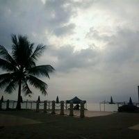 Photo taken at Pantai Teluk Kemang by Tujuh B. on 2/18/2013