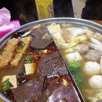 Photo taken at 藍記麻辣鍋 by vivi h. on 11/29/2012