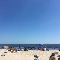 Photo taken at Rockaway Beach by Josh P. on 7/23/2016