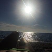 Photo taken at Spiaggia allo Scoglio by Katerina on 9/16/2014