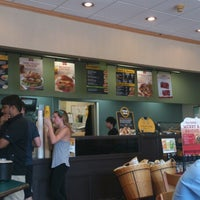 Photo taken at Einstein Bros Bagels by Juan B. on 1/1/2015