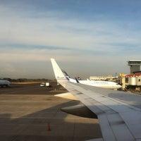 Photo taken at Gate 5 Aeropuerto Internacional Juan Santamaria by Nelson A. on 3/23/2013