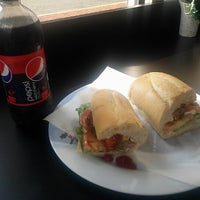 Photo taken at Uptown Market and Cafe by Creig S. on 9/27/2012