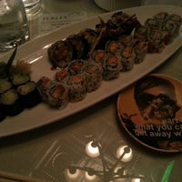 Photo taken at Moshi Sushi Bar by Valerie Y. on 4/12/2014