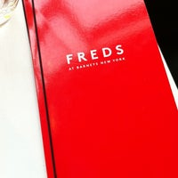 Photo taken at Fred's at Barneys New York by Gregory G. on 11/25/2012