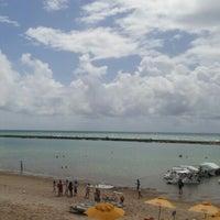 Photo taken at Praia Barra de São Miguel by Wladimir D. on 2/8/2013