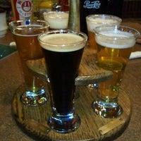 Photo taken at Triple 7 Restaurant & Brewery by Nikki on 2/25/2013