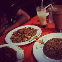 Photo taken at Food King by Xai X. on 12/24/2012
