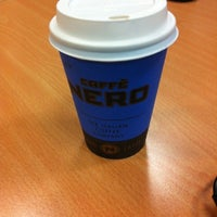 Photo taken at Caffè Nero by Grant D. on 9/25/2012