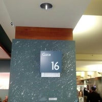 Photo taken at Gate 16 by Shawn B. on 11/2/2012