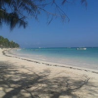 Photo taken at Los Corales Beach by Hypatia M. on 9/23/2012