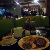 Photo taken at Roemah Keboen Family Resto and Cafe by AVI a. on 12/7/2013