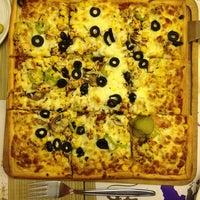 Photo taken at Kare Pizza by Atahan Ş. on 1/5/2013