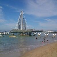 Photo taken at Playa de los Muertos by Martin R. on 1/6/2013