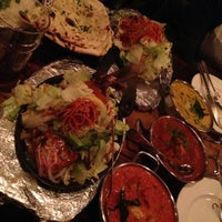 Photo taken at Brick Lane Curry House by Ashley C. on 10/20/2012