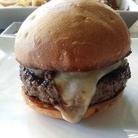 Photo taken at Umami Burger by Alex D. on 12/8/2014