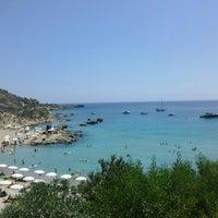 Photo taken at Konnos Beach by ChrisTina ♡ A. on 7/23/2013