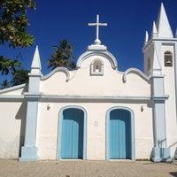 Photo taken at Praia do Forte by Mauricio K. on 12/25/2012