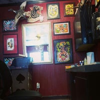 Photo taken at Death Or Glory Tattoo by Elle B. on 12/22/2012
