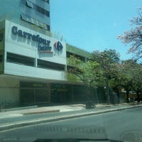 Photo taken at Carrefour Bairro by Elisa D. on 10/28/2012