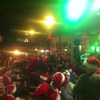 Photo taken at O'Shea's Irish Pub by SantaCon WPB on 12/15/2012