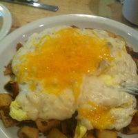 Photo taken at Echo Restaurant by Kenneth C. on 9/12/2013