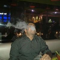 Photo taken at V Spot Bar + Cafe by Gejo J. on 3/17/2012