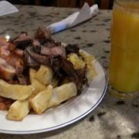 Photo taken at Oliveira's Steakhouse by Stevie G. on 8/17/2012