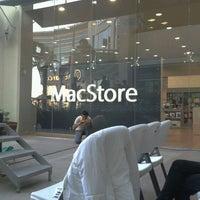 Photo taken at MacStore by abel g. on 12/23/2011