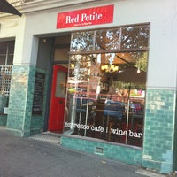 Photo taken at Red Petite Cafe by win on 1/28/2011