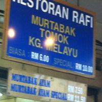 Photo taken at (Restoran Rafi) Murtabak Tomok Kg. Melayu by Zain on 1/20/2012